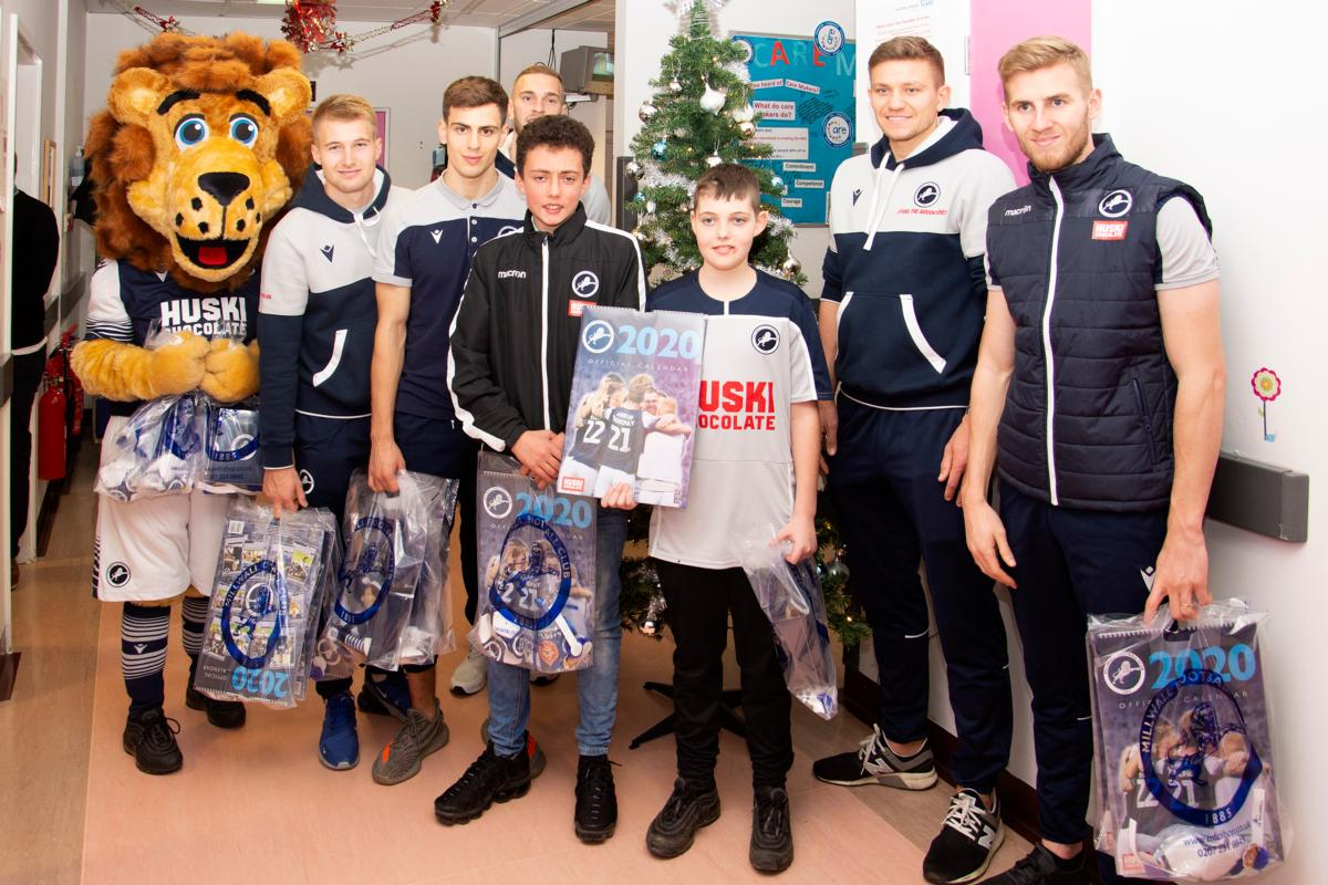 Millwall players and Zampa the Lion with patients
