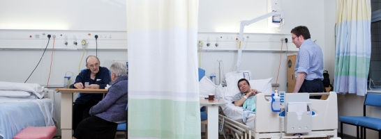 Patients on ward talking to visitors