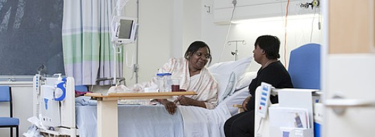 Patient talking to visitor on ward