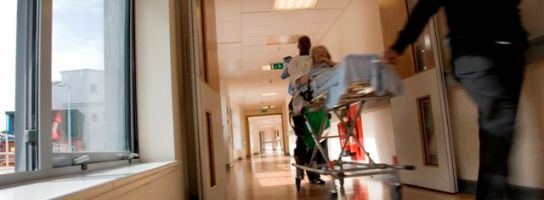Trolley with patient being pushed along corridor
